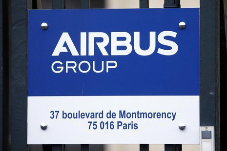 A sign shows the new logo of aircraft manufacturer Airbus Group on the entrance gate of the company's office building in Paris January 3, 20