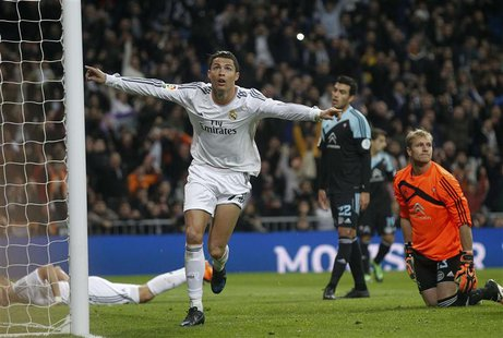 Real Madrid's Cristiano Ronaldo (C) celebrates his goal against Celta Vigo during their Spanish First Division soccer match at Santiago Bern