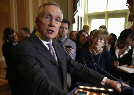 U.S. Senate Majority Leader Harry Reid (D-NV) speaks to the media following a Senate cloture vote on budget bill on Capitol Hill in Washingt