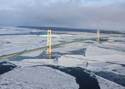 Ice forms under the Straits of Mackinac.