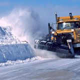 A snowplow on a highway.