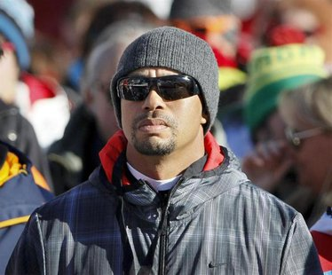 Golfer Tiger Woods of the U.S. watches the Women's World Cup Downhill skiing race in Val d'Isere, French Alps, December 21, 2013. REUTERS/Ro