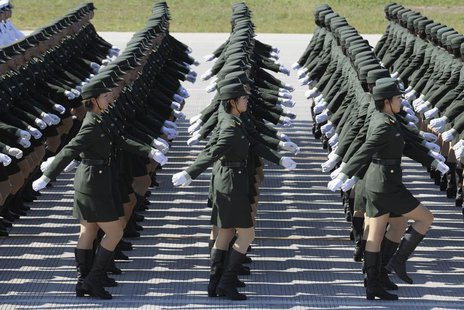Female soldiers from the Chinese People's Liberation Army (PLA) Ground Force march in formation during a training session at the 60th Nation