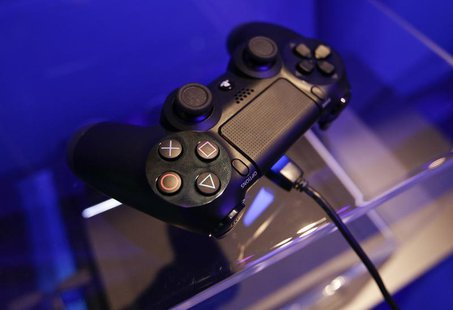 A controller of a Playstation 4 is pictured at the Sony exhibition stand during the Gamescom 2013 fair in Cologne August 21, 2013.REUTERS/In