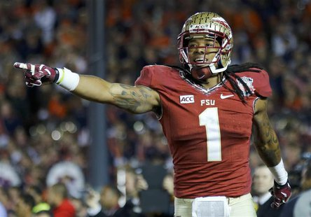 Florida State Seminoles Kelvin Benjamin celebrates after catching the game winning touchdown pass agasinst the Auburn Tigers in the fourth q
