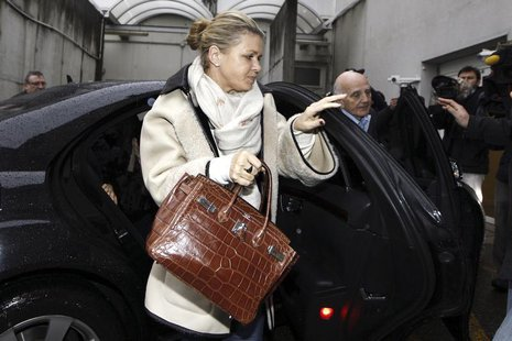 Corinna Schumacher (L), wife of former Formula One world champion Michael Schumacher, and Professor Gerard Saillant (R), president of the In
