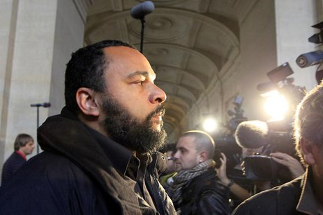 French humorist Dieudonne M'bala M'bala (L), also known as Dieudonne, arrives for the start of the trial of Ilich Ramirez Sanchez, known as