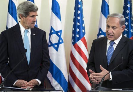 U.S. Secretary of State John Kerry listens as Israeli Prime Minister Benjamin Netanyahu makes a statement to the press before a meeting at t