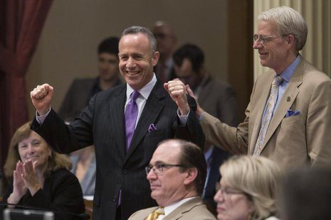 California Senate president pro tempore Darrell Steinberg (D-Sacramento) celebrates as his bill SB743 passes, which modifies the California