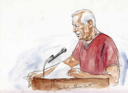 Former Pennsylvania State University football coach Jerry Sandusky addresses the court in this courtroom sketch during his sentencing hearin
