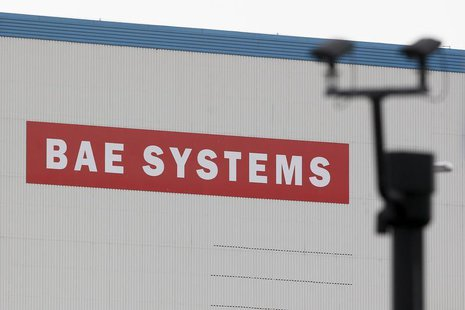 A BAE Systems sign is seen at the entrance to the naval dockyards in Portsmouth, southern England November 6, 2013. REUTERS/Stefan Wermuth