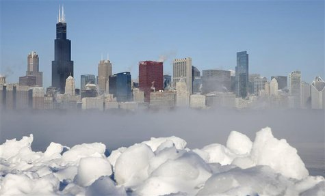 The Chicago skyline is seen beyond the arctic sea smoke rising off Lake Michigan in Chicago, Illinois, January 6, 2014. REUTERS/Jim Young