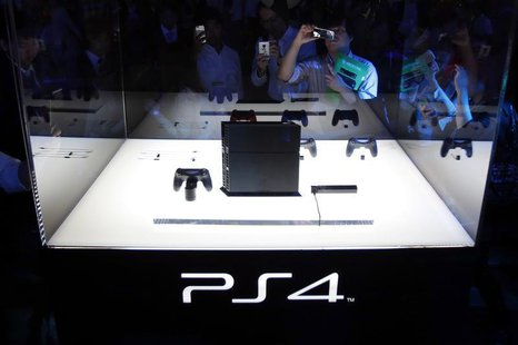 Visitors take pictures of Sony Corp's PlayStation 4 new game console at the Tokyo Game Show in Chiba, east of Tokyo, September 19, 2013. REU