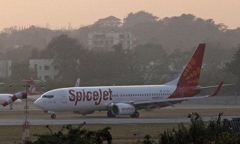 A SpiceJet Boeing 737-800 aircraft taxis on the tarmac after landing at Chhatrapati Shivaji international airport in Mumbai November 26, 201
