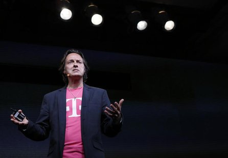 T-Mobile Chief Executive John Legere speaks during a company event in New York July 10, 2013. REUTERS/Brendan McDermid