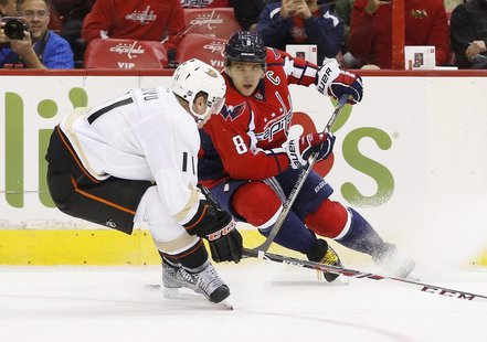 Washington Capitals right wing Alex Ovechkin (8) skates with the puck in front of Anaheim Ducks center Saku Koivu (11) in the first period a