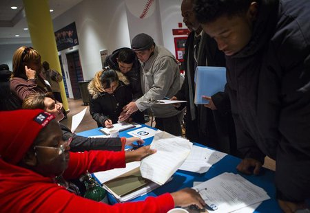 People attend a job training and resource fair at Coney Island in New York December 11, 2013. REUTERS/Eric Thayer