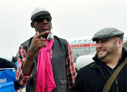 Former NBA basketball star Dennis Rodman (L) arrives at Pyongyang airport in Pyongyang, in this photo released by Kyodo January 6, 2014. REU