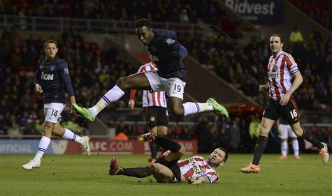 Manchester United's Danny Welbeck jumps over Sunderland's Phil Bardsley during their English League Cup semi-final first leg soccer match at