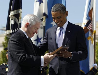 U.S. President Barack Obama presents retiring U.S. Defense Secretary Robert Gates with the Presidential Medal of Freedom during his farewell