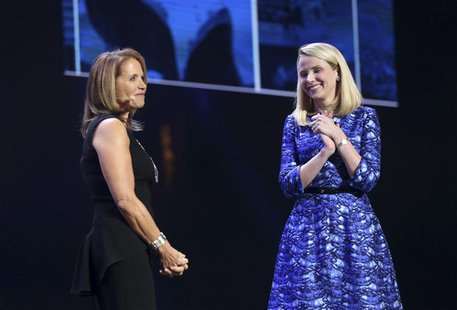 Yahoo CEO Marissa Mayer (R) greets journalist Katie Couric on stage during Mayer's keynote speech at the annual Consumer Electronics Show (C
