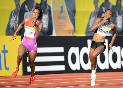 Charonda Williams of the U.S. (L) competes in the women's 200m, which she won, with Sherone Simpson of Jamaica during the Diamond League Lon