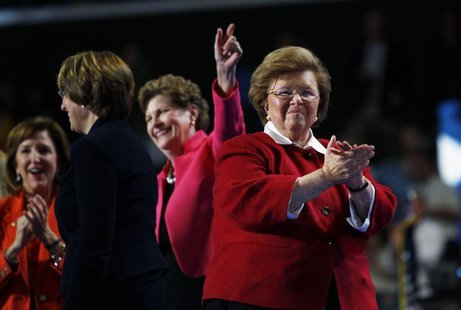 U.S. Senator Barbara Mikulski (D-MD) (R) walks off stage with fellow female members of the U.S. Senate after addressing the second session o