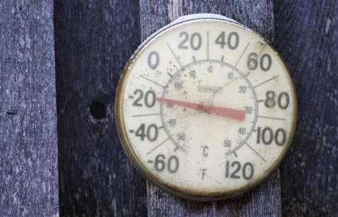 A backyard thermometer shows the temperature during winter in south Minneapolis, January 6, 2014.  CREDIT: REUTERS/ERIC MILLER