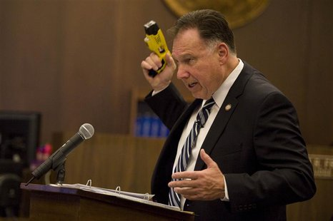 Orange County District Attorney Tony Rackauckas holds a stun gun during closing arguments in the trial of former Fullerton police officers J