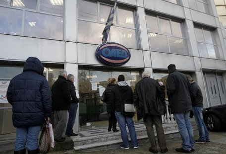 People wait outside a Greek Manpower Employment Organisation (OAED) office in an Athens suburb December 11, 2013. REUTERS/John Kolesidis