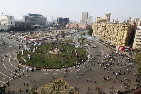 An aerial view shows security forces firing teargas to disperse a crowd in Cairo's Tahrir Square November 19, 2013. REUTERS/Mohamed Abd El G