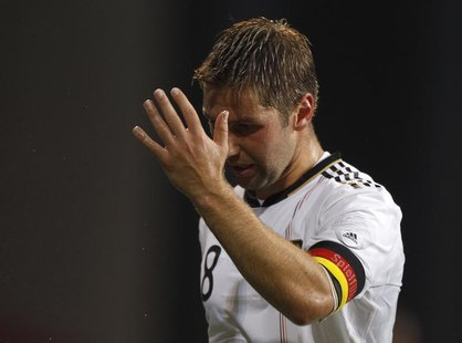 Germany's Thomas Hitzlsperger reacts during their international friendly soccer match against Denmark in Copenhagen August 11, 2010. REUTERS