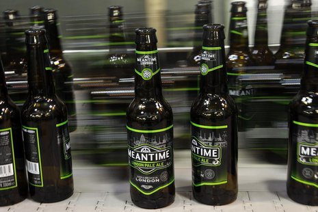 Beer bottles stand move on the production line at the Meantime brewery in east London May 10, 2012. REUTERS/Stefan Wermuth
