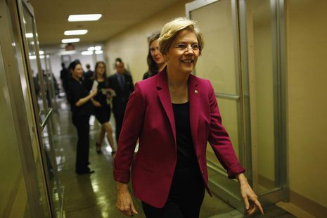 U.S. Senator Elizabeth Warren departs after the Senate passed a spending bill to avoid a government shutdown, sending the issue back to the