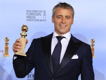 "Matt LeBlanc holds his award for best performance by an actor in a television series - comedy or musical, for ""Episodes,"" backstage at the 6"