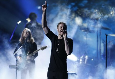 Dan Reynolds of Imagine Dragons performs a medley at the 41st American Music Awards in Los Angeles, California November 24, 2013. REUTERS/Lu
