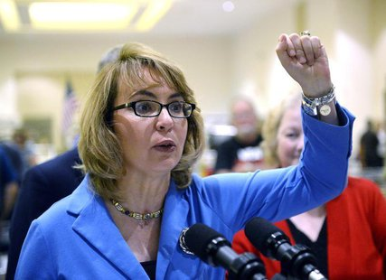 Former U.S. Rep. Gabrielle Giffords speaks to reporters during the New Eastcoast Arms Collectors Associates Arms Fair at the Saratoga Spring