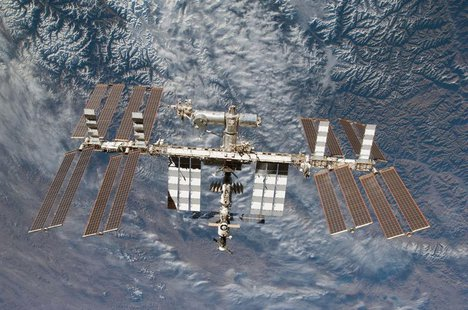 Backdropped by Earth, the International Space Station is seen in this image photographed by an STS-130 crew member on space shuttle Endeavou