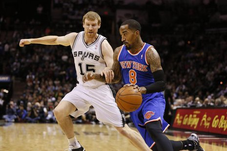 Jan 2, 2014; San Antonio, TX, USA; New York Knicks guard J.R. Smith (8) drives to the basket while guarded by San Antonio Spurs forward Matt