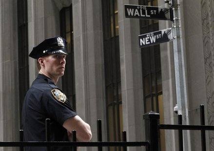 A New York City police officer stands outside the New York Stock Exchange, on Wall Street, May 14, 2012. REUTERS/Brendan McDermid