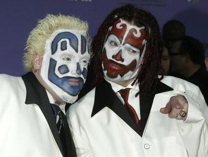 Members of the Insane Clown Posse pose as they arrive at the 2003 Billboard Music Awards at the MGM Grand Garden Arena in Las Vegas, Nevada,