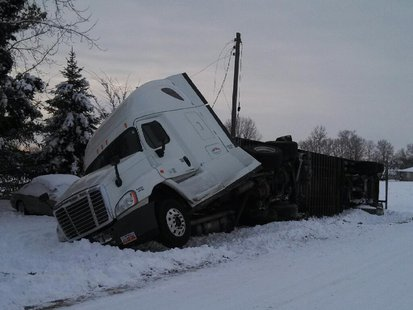 01-07-14 semi overturns on SR42 after slipping off road. photo provided by Vigo County Sheriff