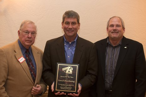 Pictured are Sheboygan A's General Manager Denny Moyer (left) and President Scott Stangel (right) with Tyson Gutschow (middle), co-owner of Larry's Distributing. Larry's Distributing was selected as the 2013 Sheboygan A's Sponsor of the Year.