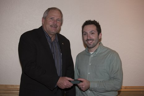 Sheboygan A's President Scott Stangel (left) presents newly elected Vice President C.J. Skelton (right) with the 2013 Sheboygan A's Golden A Award.