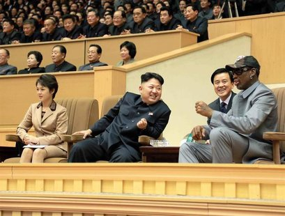 North Korean leader Kim Jong Un (2nd L) watches a basketball game between former U.S. REUTERS/KCNA
