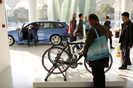 People are seen inside the BMW Experience Center in Shanghai November 19, 2013. REUTERS/Aly Song