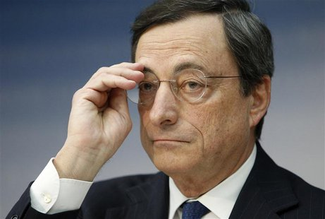European Central Bank (ECB) President Mario Draghi adjusts his glasses during the monthly ECB news conference in Frankfurt December 6, 2012.