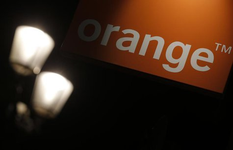 The logo of the Orange telecommunication and internet provider is seen on the facade of a store in Paris July 24, 2013. REUTERS/Christian Ha