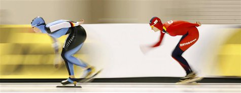 Germany's Claudia Pechstein (L) skates to a second place finish against Czech Republic's Martina Sablikova in the Women's 5000m race at the