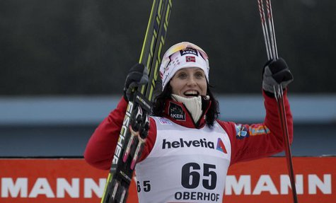 Norway's Marit Bjoergen reacts after winning in the women's cross country Tour de Ski 3 km free individual competition in the eastern German